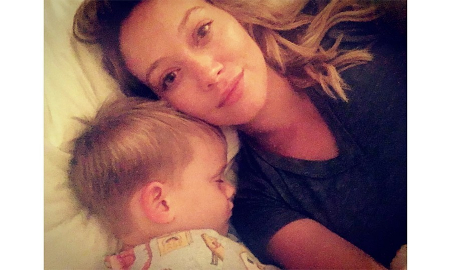 "Hilary Duff was ""feeling grateful"" as she snuggled up close to her sleeping four-year-old Luca. 
