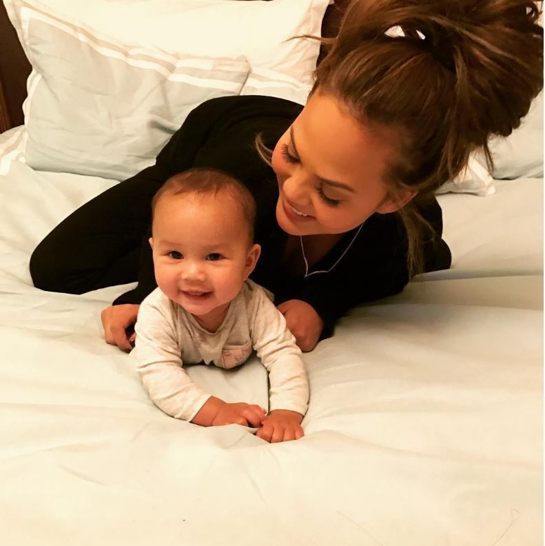 John Legend and Chrissy Teigen celebrated Luna's six month birthday with sweet photos of their daughter on Instagram. Luna celebrated with her first trip to an NYC park with her mom. 
