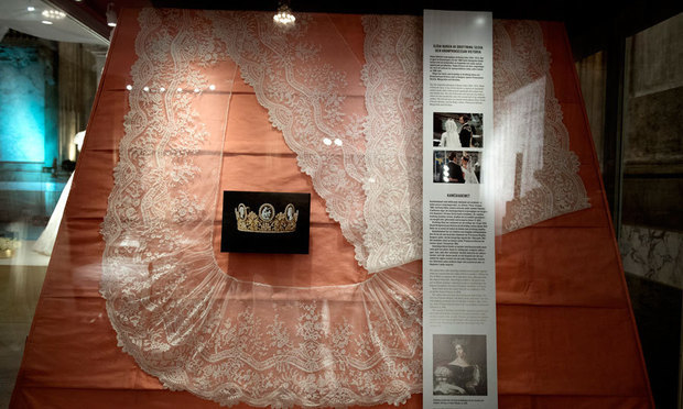 Veils worn by the monarch and her eldest daughter are also showcased at the exhibit.