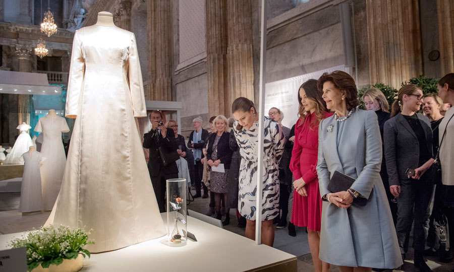 Queen Silvia looked at her royal wedding gown by Marc Bohan for Christian Dior.