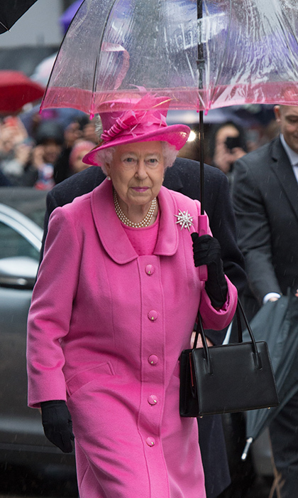No one wears colour like seasoned show-stopper Queen Elizabeth, who matched her umbrella to her bubblegum-hued ensemble for a visit to Birmingham.
