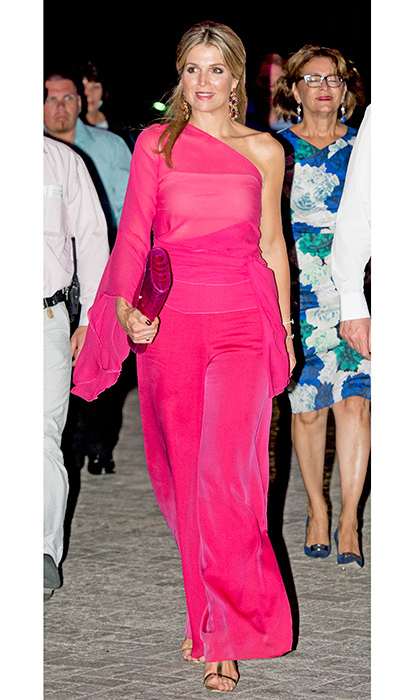 Queen Maxima of the Netherlands was sizzling in a hot-pink one-shoulder number with a matching clutch for her visit to Aruba.