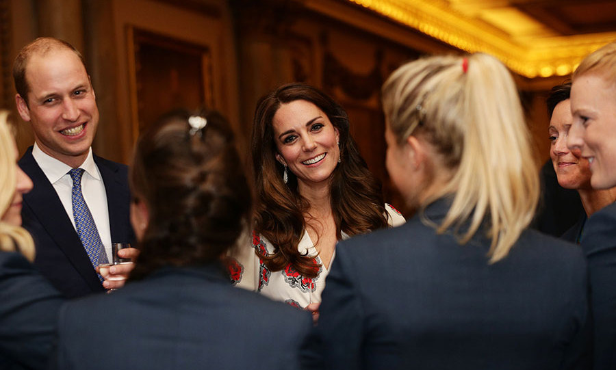 Kate oozed heaps of glamour in a striking floor-length white Alexander McQueen gown, which was emblazoned with patriotic red poppies. Her brunette tresses were left loose over her shoulders in gorgeous curls.