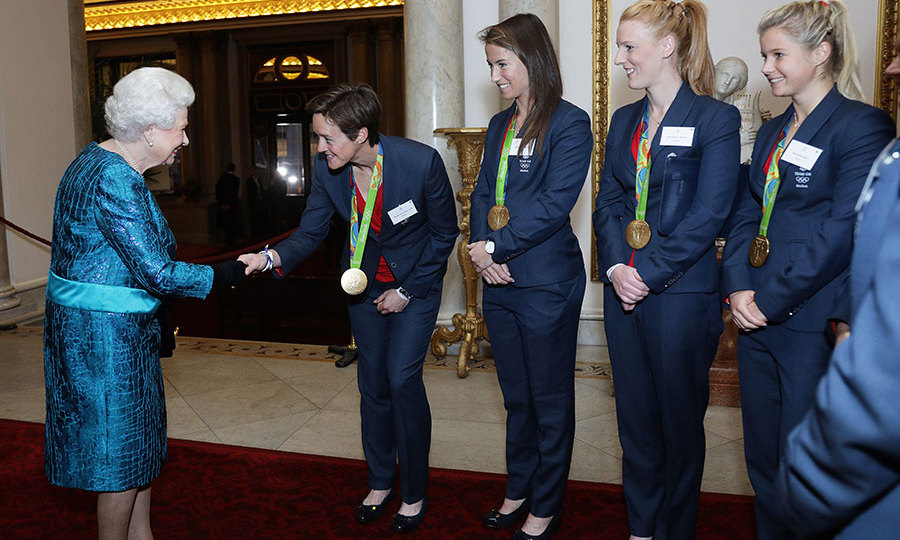The Queen looked splendid in turquoise as she was introduced to Team GB and Paralympics GB medallists.