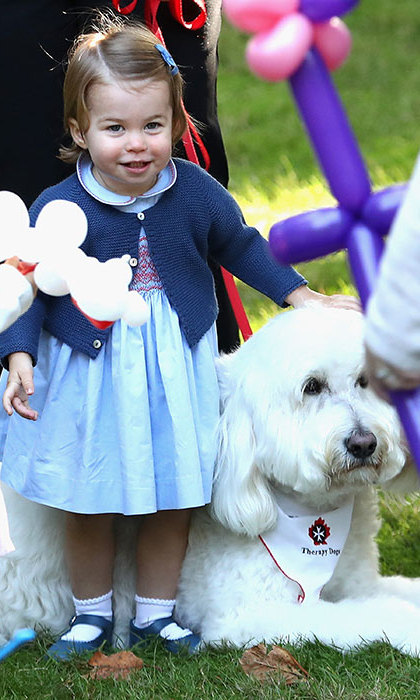 Princess Charlotte was seen playing with a dog called Moose at a party during the royal tour of Canada. 