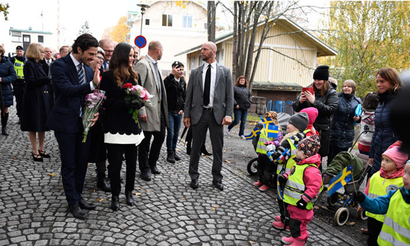 Young children lined the streets hoping to catch a glimpse of the royal couple.