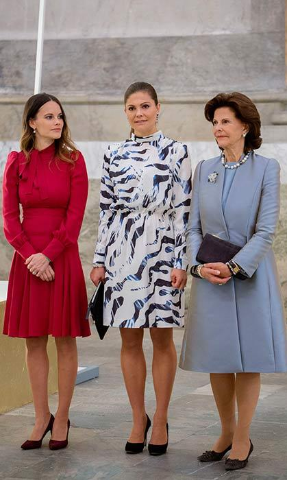 Princess Sofia, Crown Princess Victoria and Queen Silvia of Sweden made a stylish trio as they attended the opening of a royal wedding dress exhibition.