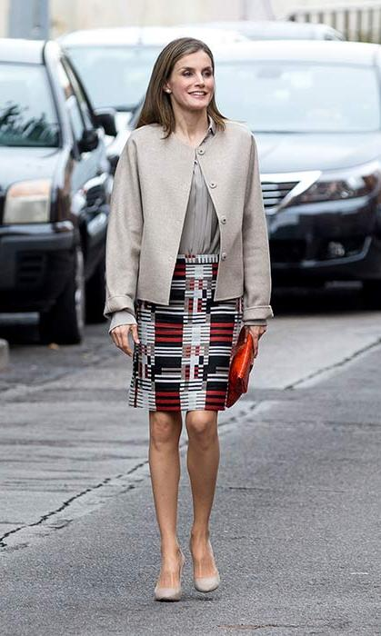 A patterned skirt adds a bold colour pop to Queen Letizia's neutral ensemble.
