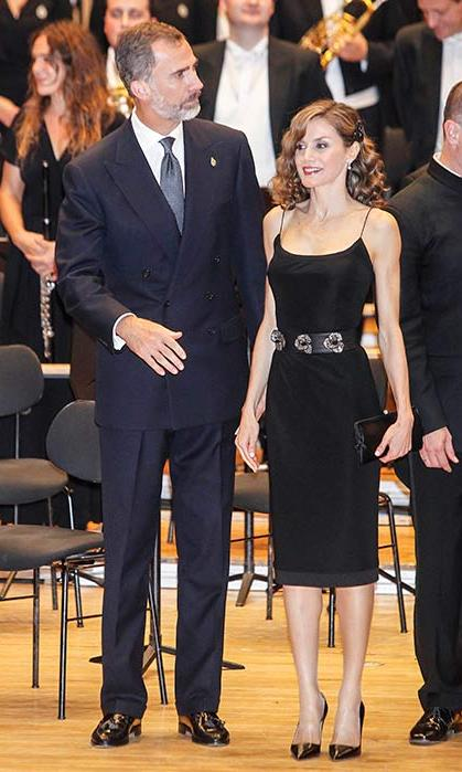 The Spanish monarch highlighted her slim physique in a black dress with floral waist belt detail.