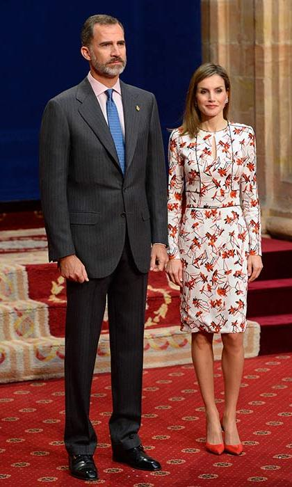 Queen Letizia looked elegant in a floral print dress and red heels at the delivery of the Princess of Asturias awards medals.