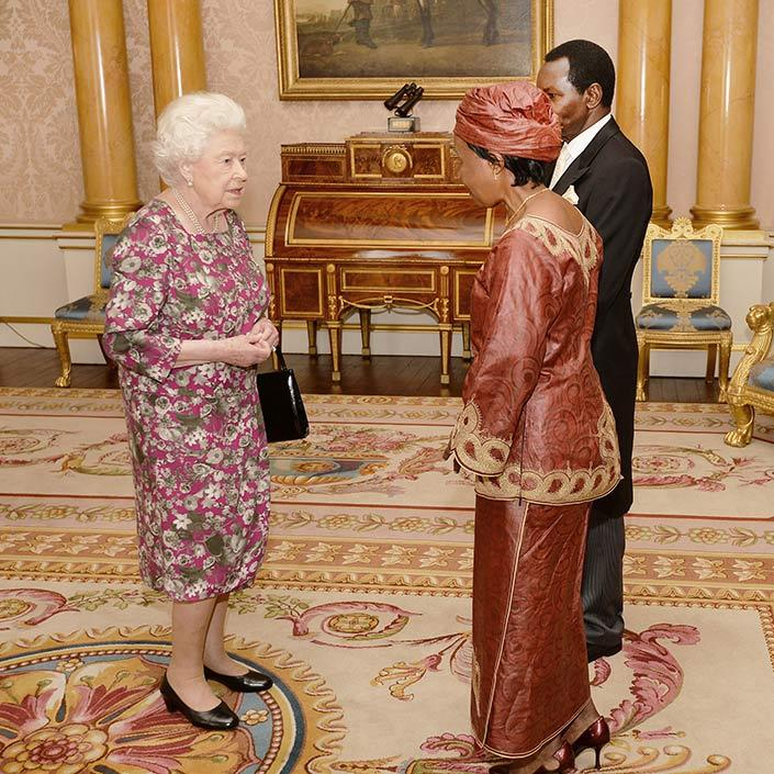 The Queen wore a pink floral dress to welcome the High Commissioner of Tanzania to Buckingham Palace.