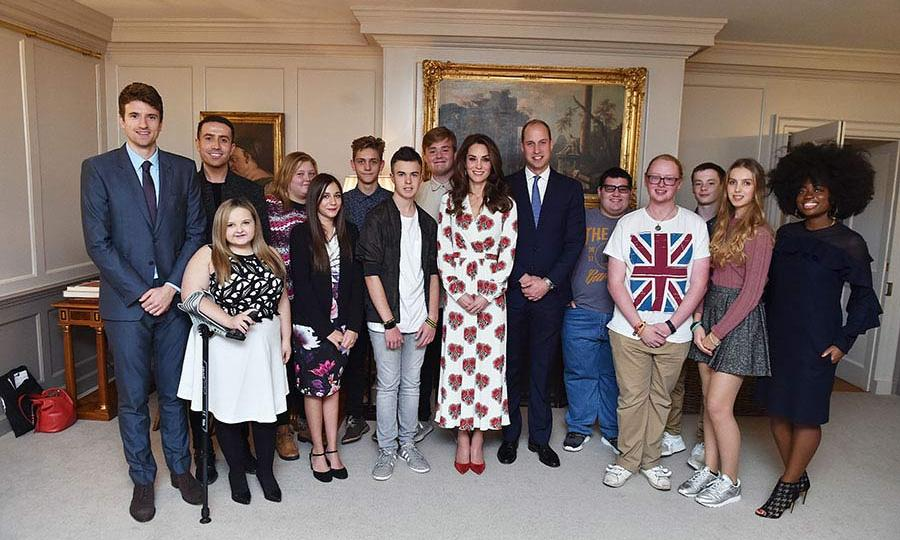 The Duchess of Cambridge wore a striking Alexander McQueen poppy print dress at a reception at Kensington Palace on Tuesday.