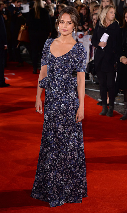 Alicia Vikander worked a vintage-inspired custom Louis Vuitton gown, a delicate floral confection with a peplum waist, while promoting <em>The Light Between Oceans</em> in London.