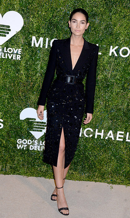 Lily Aldridge proves that head-to-toe black is anything but boring in this belted blazer dress by Michael Kors Collection, which she wore with strappy heels.