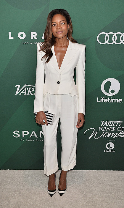 Naomie Harris gives us a masterclass in power dressing in this white trouser suit, paired with stripy monochromatic accessories.