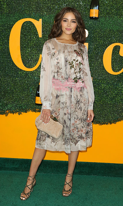 Olivia Culpo channeled feminine style in this delicate floral print dress.