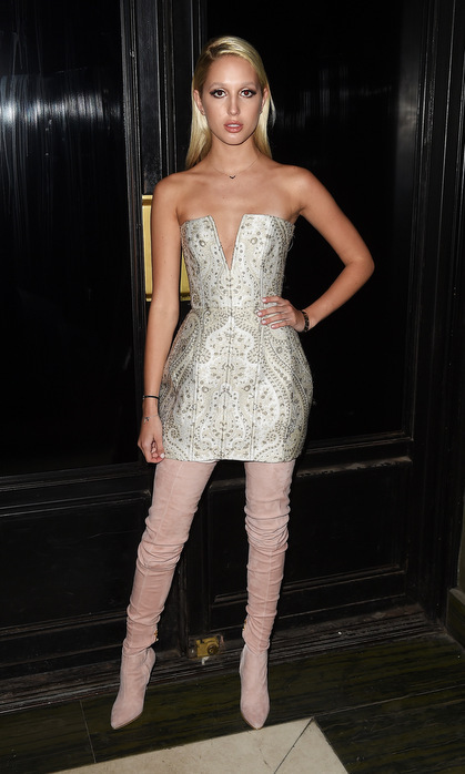 Princess Olympia joined the Balmain army at Olivier Rousteing's 2016 Met Gala after-party wearing a structured mini dress with a deep V-neck and blush suede thigh-high boots.