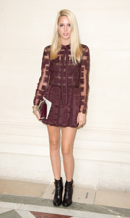 The fashionista turned heads in a sheer-sleeved burgundy mini dress at Valentino's Fall/Winter 2014-2015 presentation during Paris Fashion Week.