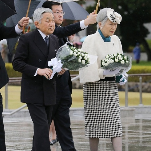 The royal couple oozed elegance — Michiko's houndstooth skirt is just fabulous — at an otherwise somber event honouring Hiroshima victims in December 2014. 
