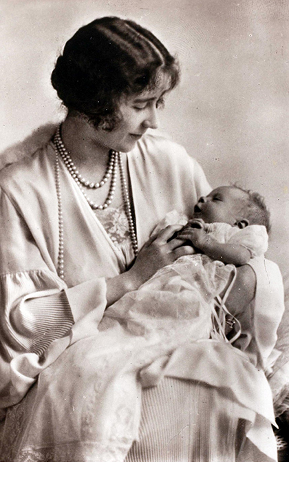 "Elizabeth Bowes-Lyon cradles her daughter, Princess Elizabeth. ""I know Elizabeth wanted a daughter,"" said delighted dad Prince Albert (known as Bertie), who would become King George VI when his older brother abdicated.