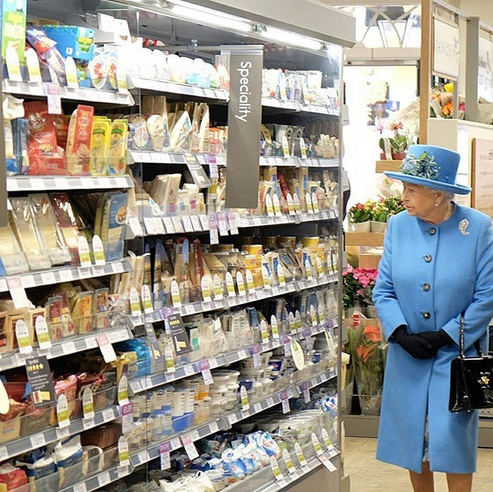 During an Oct. 2016 visit to Poundbury, a new urban development on the edge of Dorchester, England, Queen Elizabeth popped into local supermarket to meet with staff and check out the locally sourced produce.