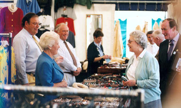 Perhaps they offer a royal discount? The Queen chatted with salespeople during a shopping trip to the Trade Stands at the Royal Windsor Horse Show in Berkshire. 