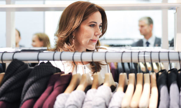 Crown Princess Mary of Denmark admired clothing during her official visit to Canada in 2014.