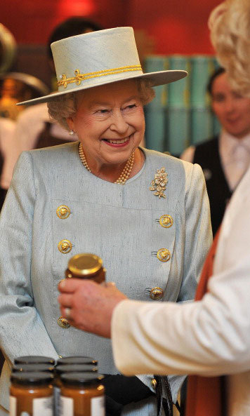 A jar of joy! The Queen during her visit to Piccadilly's Fortnum and Mason store in 2012, where she was shown jars of preserves.