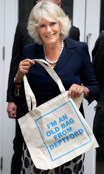 Saving the planet, one shopping bag at a time. The Duchess of Cornwall was gifted an eco canvas bag after visiting the the 999 Club in London back in 2009.