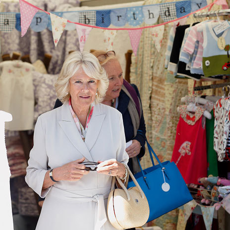 Perhaps purchasing for George and Charlotte? The Duchess of Cornwall visited the children's clothing section of the trades stands during the 2015 Royal Windsor Horse Show.