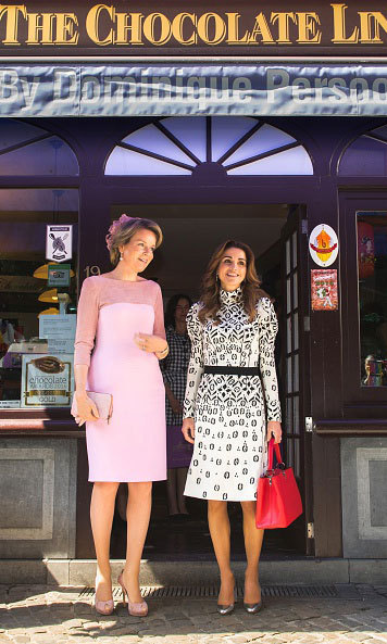 Shopping buddies! Queen Mathilde of Belgium (left) and Queen Rania of Jordan (right) paid a visit to Bruges' The Chocolate Line shop in 2016.