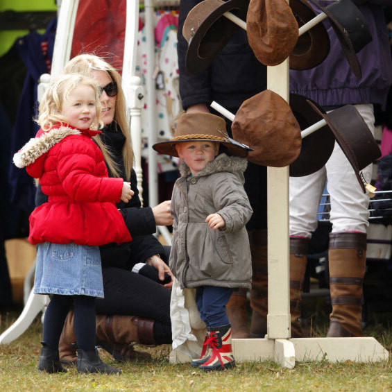 If the hat fits, buy it! Isla Phillips tried on an oversized chapeau with her mother Autumn Phillips and older sister Savannah Phillips at the Gatcombe Horse Trials in 2014.