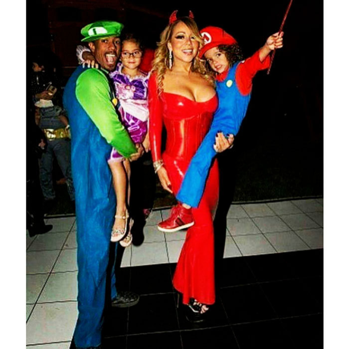 "Exes Nick Cannon and Mariah Carey got into the Halloween spirit with their twins, Monroe and Moroccan. The former couple's daughter opted for a Rapunzel costume from Disney's Tangled film, while her mother dressed as a sultry red devil. Meanwhile, Nick and his son coordinated as the Super Mario Brothers. Attached to the family photo, Nick wrote, ""Early Halloween Family Flow! #Ncredible.""