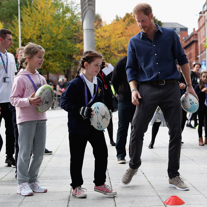 The popular royal appeared to be having a wonderful time as he played with schoolchildren, during his visit to Nottingham's National Ice Centre.