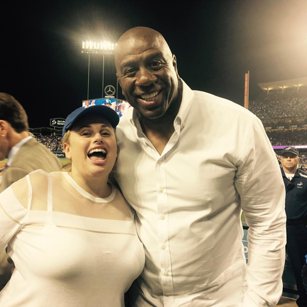 Rebel Wilson is all of us with basketball legend Magic Johnson at a Los Angeles Dodgers game.