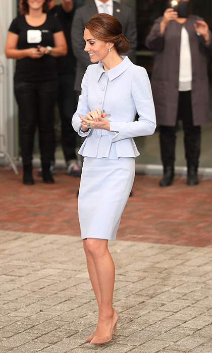 The Duchess of Cambridge wore a pale-blue Catherine Walker skirt suit for her arrival in the Netherlands, her first solo tour since becoming a royal. <br>Photo: © PA