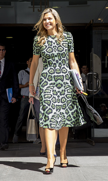Queen Maxima of the Netherlands showed her wild side in a green leopard-print A-line Givenchy dress to attend a conference at Universidad Católica de Buenos Aires. <br>Photo: © Getty Images
