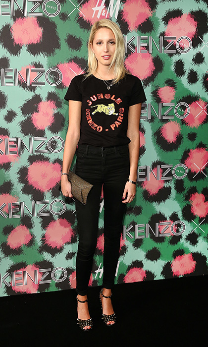 Princess Olympia of Greece attended the KENZO x H&M fashion show in New York wearing an embellished tee from the collection and black skinny pants. She paired the look with a studded Valentino clutch and matching pumps. <br>Photo: © Getty Images