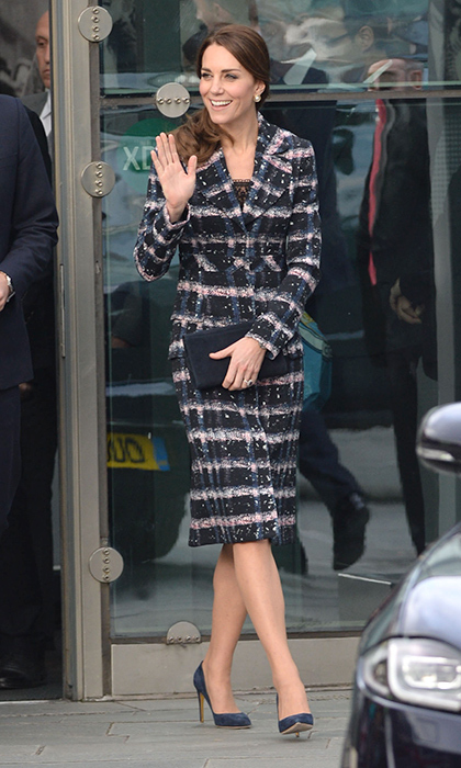 The Duchess of Cambridge kept warm in a palette of grey, pink, blue and black courtesy of this striking Erdem coat, which she selected for a day of engagements in Manchester. 