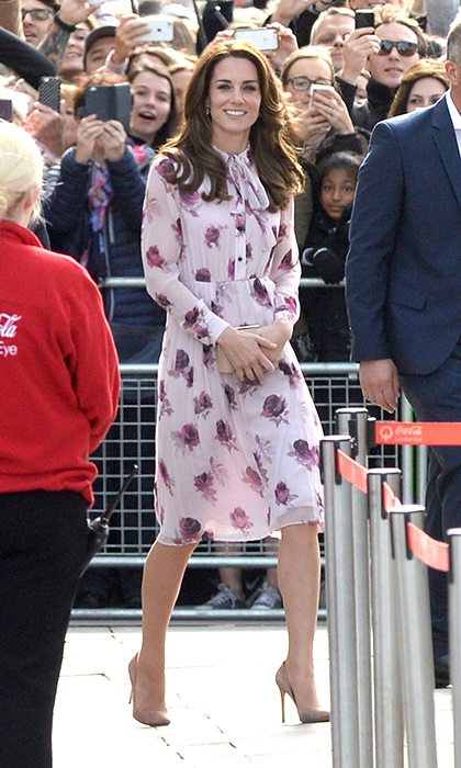 Kate stepped out in a pretty pink and floral printed dress by Kate Spade for World Mental Health Day in London.<br>Photo: © PA