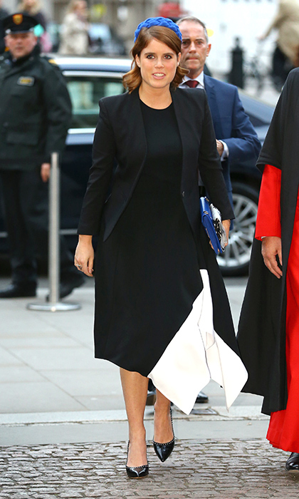 Princess Eugenie donned an asymmetrical black-and-white dress and blue felt hat for a service and wreath laying at Westminster Abbey. 