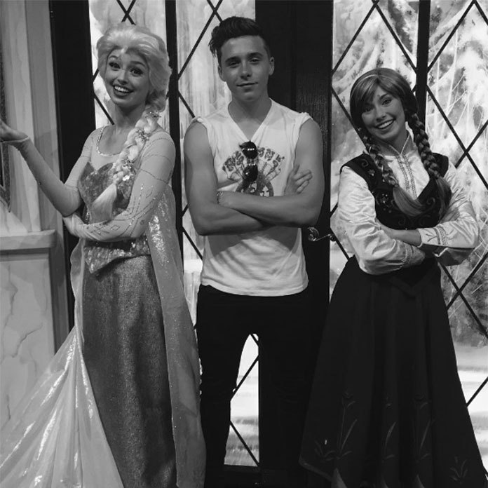 Brooklyn Beckham proved to be the ultimate ladies man while visiting Disneyland - he couldn't resist posing for a picture with Elsa and Anna.