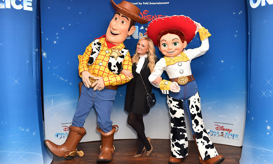 <em>Toy Story</em> fan Emma Bunton reassures us that Baby Spice will never grow up, pictured with Woody and Jessie at Disney on Ice.