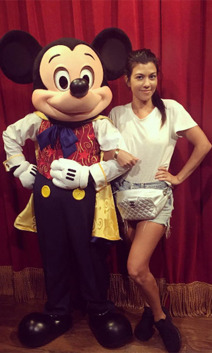 Kourtney Kardashian effortlessly co-ordinates her Mickey Mouse bag with the main man himself, proving that Disney and fashion go hand in hand.