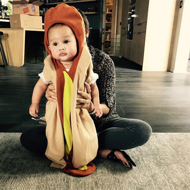 Chrissy Teigen treated followers to a Halloween fashion show with daughter Luna on Instagram, including this too-cute hot dog costume. 