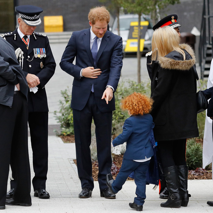 What are those?! Prince Harry checked out the snazzy shoes of a young redhead at the Metropolitan Police Service annual Ceremony of Remembrance at the Metropolitan Police Training College in London.