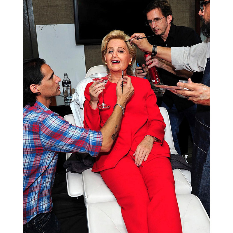 I'm with her! Katy Perry showed her election colours by trying Hillary Clinton's iconic red suit (and face!) on for size. She attended Kate Hudson's Halloween shindig with a Bill Clinton played by her agent Michael Kives.