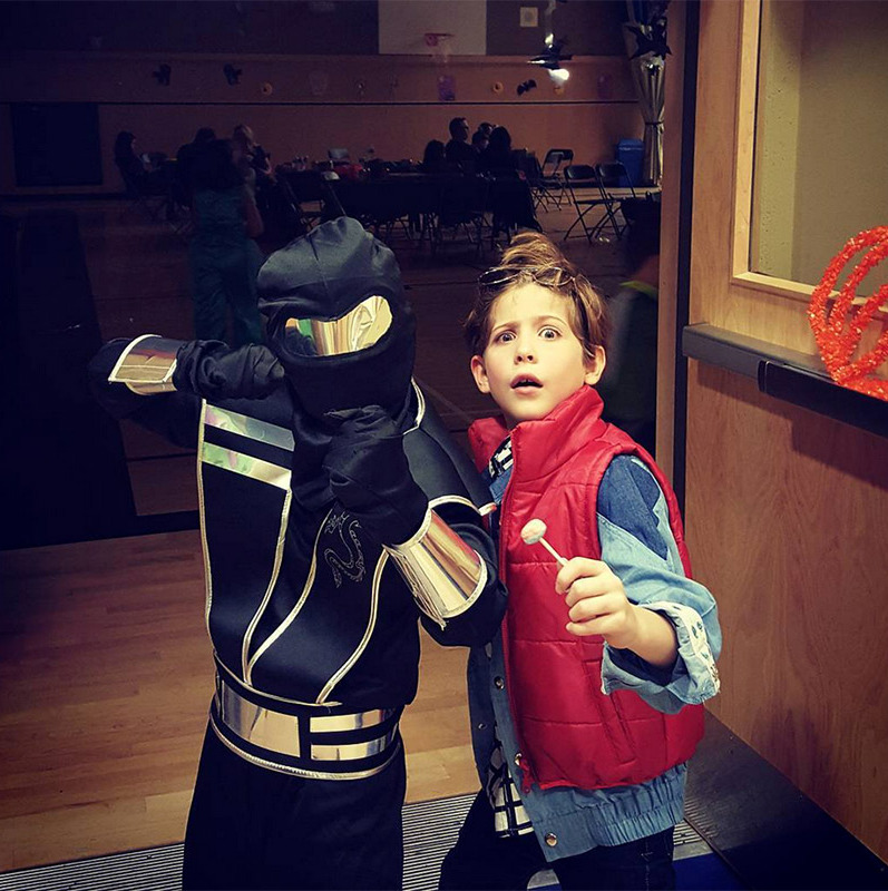 """Rollin' up to my school #Halloween dance as the flyest guy I know!"" Jacob Tremblay, a.k.a. <em>Back To The Future</em>'s Marty McFly, captioned this photo with his superhero friend.