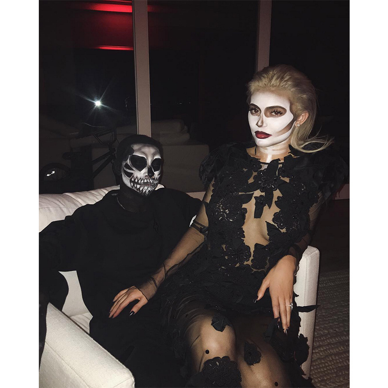 """thanks for joining our dinner tonight "" said a ghoulish Kylie Jenner, posing with boyfriend Tyga. 