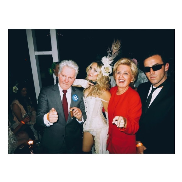 The singer was joined at Kate Hudson's party by her boyfriend Orlando Bloom, who was transformed into Donald Trump.